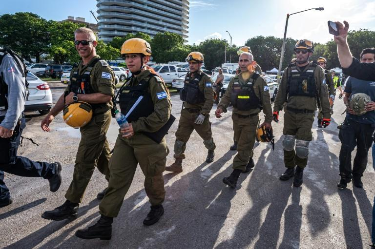 An Israeli rescue team arrive near the collapse building in Surfside on June 27, 2021