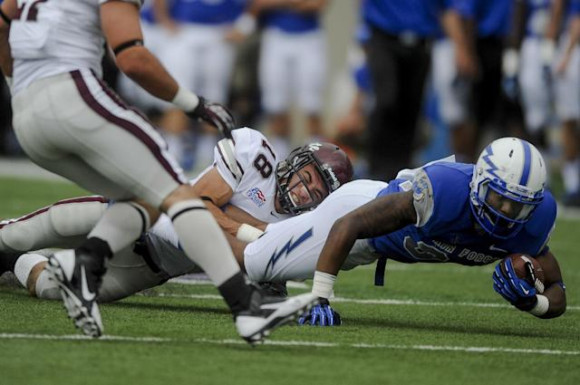 Air Force wide receiver Demario Kohn, right, gets tackled by Colgate defensive back Mike Armiento during an NCAA college football game Saturday, Aug., 31, 2013, in Air Force Academy, Colo. (AP Photo/The Colorado Springs Gazette, Michael Ciaglo)