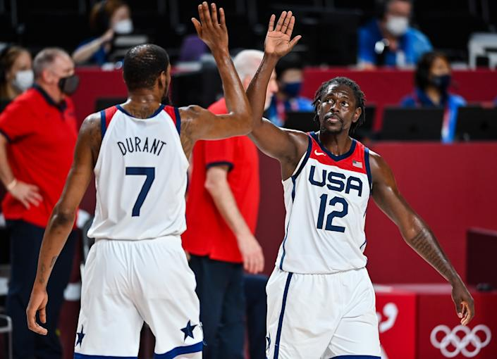 Jrue Holiday, right, and Kevin Durant led the way as USA men's basketball beat France to win Olympic gold. (Brendan Moran/Sportsfile via Getty Images)