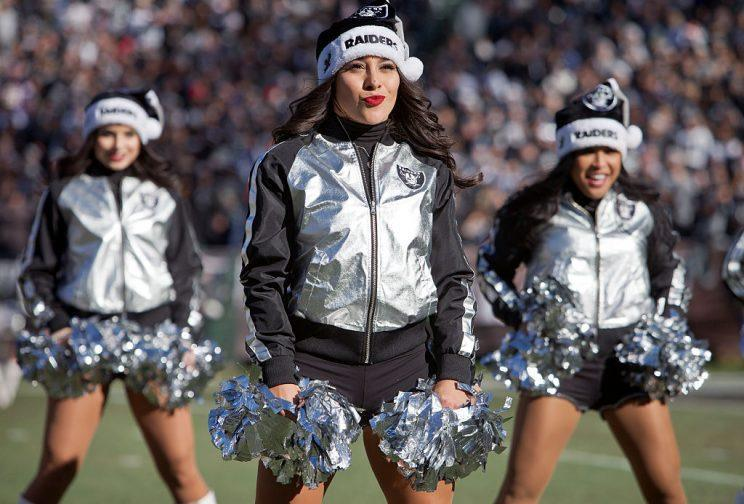 Oakland Raiders cheerleaders have settled with the team over back pay. (Getty)