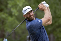 CORRECTS FARAWAY TO FAIRWAY Dustin Johnson watches his drive down the ninth fairway during the first round of the Palmetto Championship golf tournament in Ridgeland, S.C., Thursday, June 10, 2021. (AP Photo/Stephen B. Morton)
