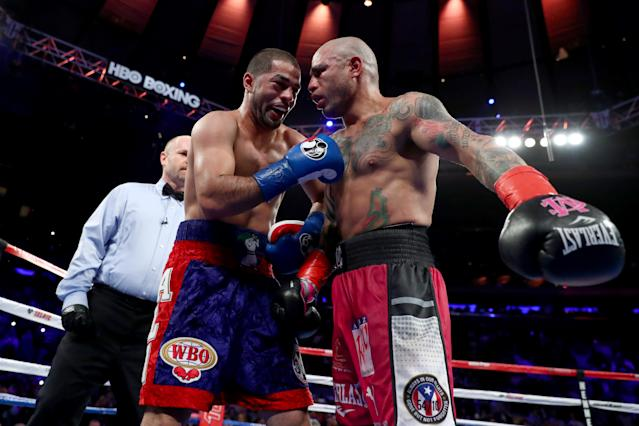 Sadam Ali (L) and Miguel Cotto embrace after Ali defeated Cotto by unanimous decision Saturday at Madison Square Garden in New York in what Cotto said was his final fight. (Getty)