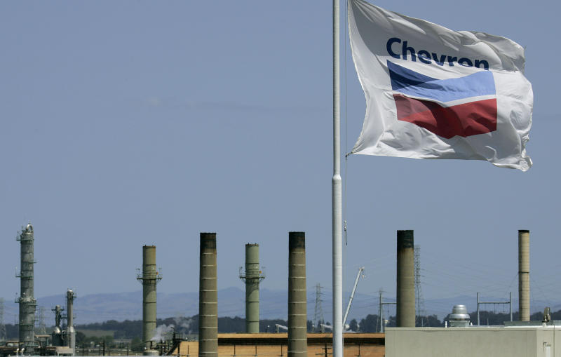 FILE - This April 21, 2008 file photo shows a Chevron flag flying over the Chevron refinery in Richmond, Calif. Chevron Corp. is facing millions of dollars in additional taxes for its refinery in Richmond after an appeals board ruled that the refinery was worth more than the county's assessment. (AP Photo/Ben Margot)