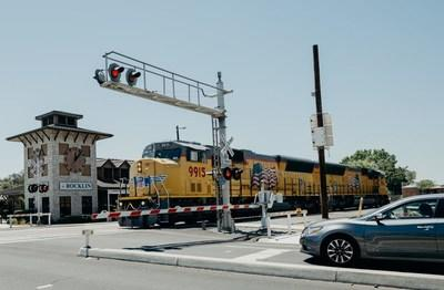 A driver stops as railroad signals activate for an approaching train in Rocklin, California. Union Pacific's Rail Safety Week efforts will raise awareness about the importance of safely crossing train tracks.