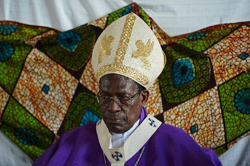 Archbishop Simon Ntamwana leads a church service in Shombo, Burundi on March 15, 2015 (AFP Photo/Carl de Souza)