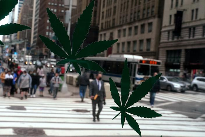 Cannabis stickers on a Weed World store window are pictured the day New York State legalized recreational marijuana use amid the coronavirus disease (COVID-19) pandemic in the Manhattan borough of New York City, New York, U.S., March 31, 2021. REUTERS/Carlo Allegri