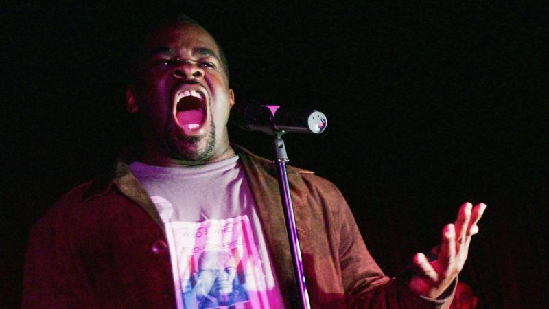 """Craig Grant (aka muMs) performs poetry at the Alicia Keys """"Tears For Water"""" book release party on November 9, 2004."""