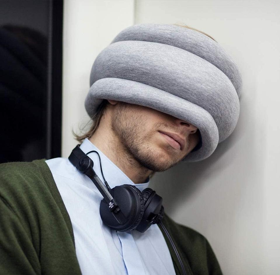 "<h3><h2>Ostrich Pillow Light</h2></h3><br>While the primary benefit of the internet-<a href=""https://www.thegrommet.com/our-makers/ostrich-pillow-napping-pillow"" rel=""nofollow noopener"" target=""_blank"" data-ylk=""slk:famous Ostrich Pillow"" class=""link rapid-noclick-resp"">famous Ostrich Pillow</a> is to block light and provide a cushy surface (and hilarious appearance) with which to nap, the wraparound design also has mild sound-muffling effects, too.<br><br><em>Shop</em> <strong><em><a href=""http://ostrichpillow.com"" rel=""nofollow noopener"" target=""_blank"" data-ylk=""slk:Ostrich Pillow"" class=""link rapid-noclick-resp"">Ostrich Pillow</a></em></strong><br><br><strong>OstrichPillow</strong> Ostrich Pillow Light, $, available at <a href=""https://amzn.to/38bQpz3"" rel=""nofollow noopener"" target=""_blank"" data-ylk=""slk:Amazon"" class=""link rapid-noclick-resp"">Amazon</a>"
