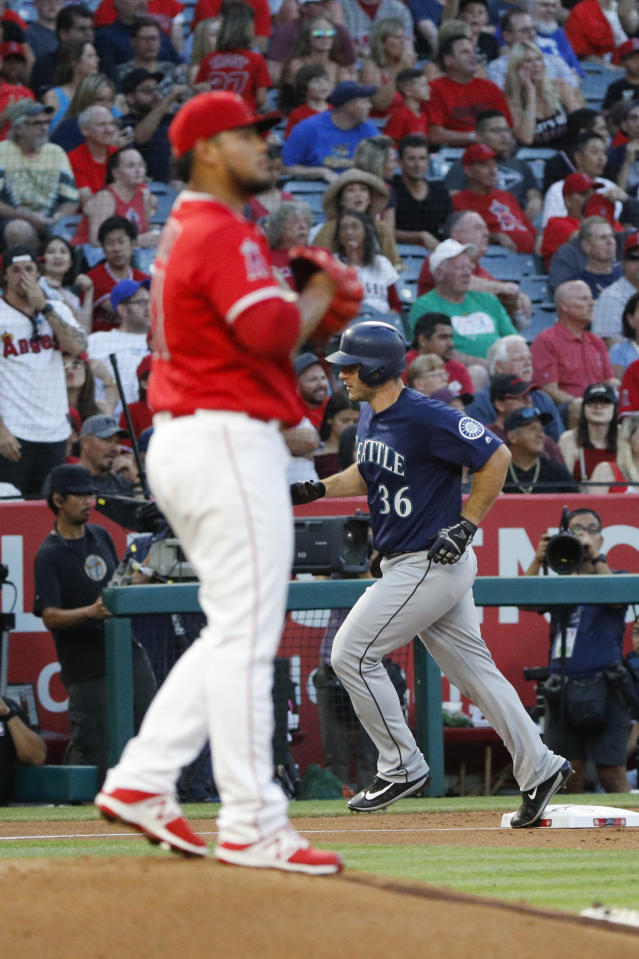 Seattle Mariners' David Freitas, right, rounds the bases after hitting a home run off Los Angeles Angels starting pitcher Jaime Barria, foreground, during the third inning of a baseball game Wednesday, July 11, 2018, in Anaheim, Calif. (AP Photo/Jae C. Hong)
