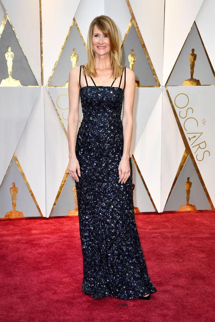 <p>Laura Dern's Rodarte gown fit her like a glove — and the fun details like multiple straps and shining navy blue fabric added to the overall effect too. <em>(Photo: Getty Images)</em> </p>
