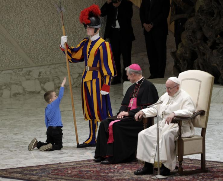 Pope charmed by 'undisciplined' hearing impaired child