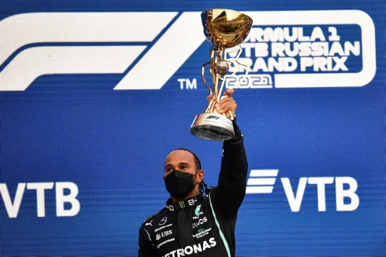 Mercedes British driver Lewis Hamilton brought up an unprecedented 100th Grand Prix success after a drama-filled race in Russia (AFP/Alexander NEMENOV)