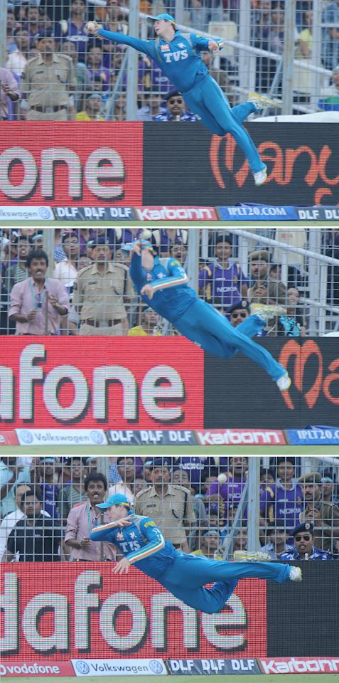 This combination of three photographs show Pune Warriors India fielder Steve Smith attempting a catch at the boundary line during the IPL Twenty20 cricket match between Kolkata Knight Riders and Pune Warriors at The Eden Gardens in Kolkata on May 5, 2012.  RESTRICTED TO EDITORIAL USE. MOBILE USE WITHIN NEWS PACKAGE.  AFP PHOTO/Dibyangshu SARKAR        (Photo credit should read DIBYANGSHU SARKAR/AFP/GettyImages)