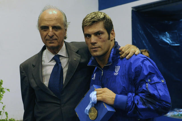 AVEZZANO, ITALY - JULY 02: Gold medalist Clemente Russo of Italy and Mario Pescante of Italy after the medal ceremony Men's Heavy 91kg final on day 6 during the XVI Mediterranean Games at the Sports Hall Pala Ghiaccio on July 2, 2009 in Avezzano, Italy. (Photo by Getty Images/Getty Images)