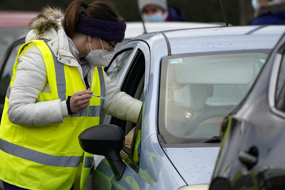 HYDE, ENGLAND - JANUARY 08: A man sits in his car as he is administered the Pfizer/BioNTech coronavirus vaccine at a drive-thru COVID-19 vaccination centre at Hyde Leisure Centre on January 08, 2021 in Hyde, England. The coronavirus drive-through vaccine centre is believed to be the first in the world. (Photo by Christopher Furlong/Getty Images)