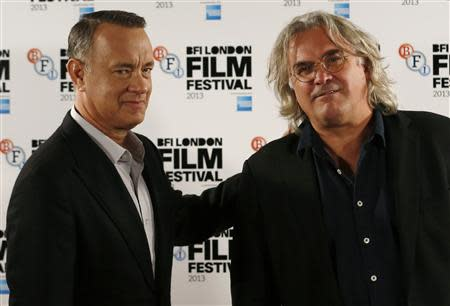 "Actor Tom Hanks (L) and director Paul Greengrass attend a photocall for their film ""Captain Phillips"" during the BFI (British Film Institute) London Film Festival October 9, 2013. REUTERS/Luke MacGregor"