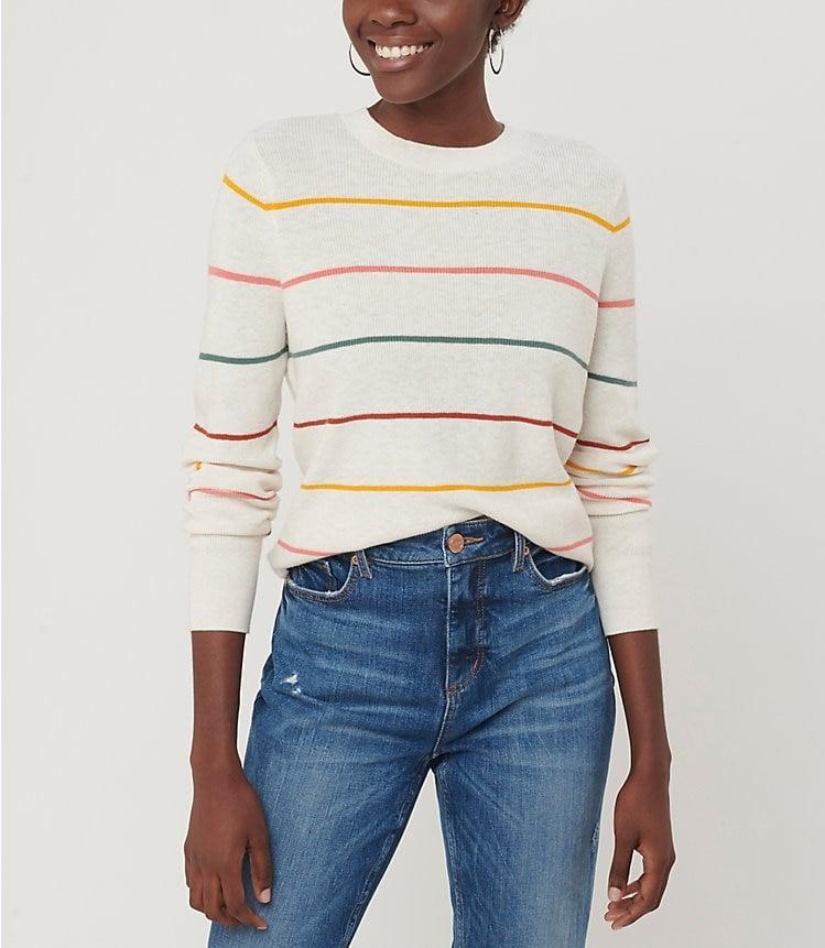 <p>This rainbow <span>Loft Striped Modern Crew Neck Sweater</span> ($50) would look great with jeans.</p>