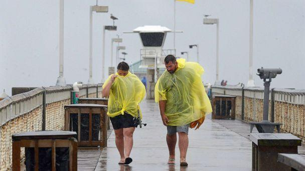PHOTO: People use ponchos to stay dry as thei walk along the Okaloosa Island Fishing Pier on Sept. 15, 2021 in Ft. Walton, Fla. Heavy rains from Tropical Depression Nicholas continues as Tropical Storm Nicholas makes its way across Texas and Louisiana. (Devon Ravine/Imagn via USA Today Network)