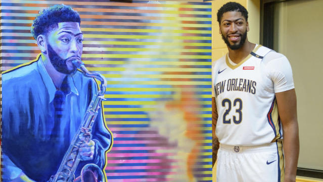 "<a class=""link rapid-noclick-resp"" href=""/nba/players/5007/"" data-ylk=""slk:Anthony Davis"">Anthony Davis</a> poses next to a painting of himself playing a saxophone on media day, of course. (AP)"