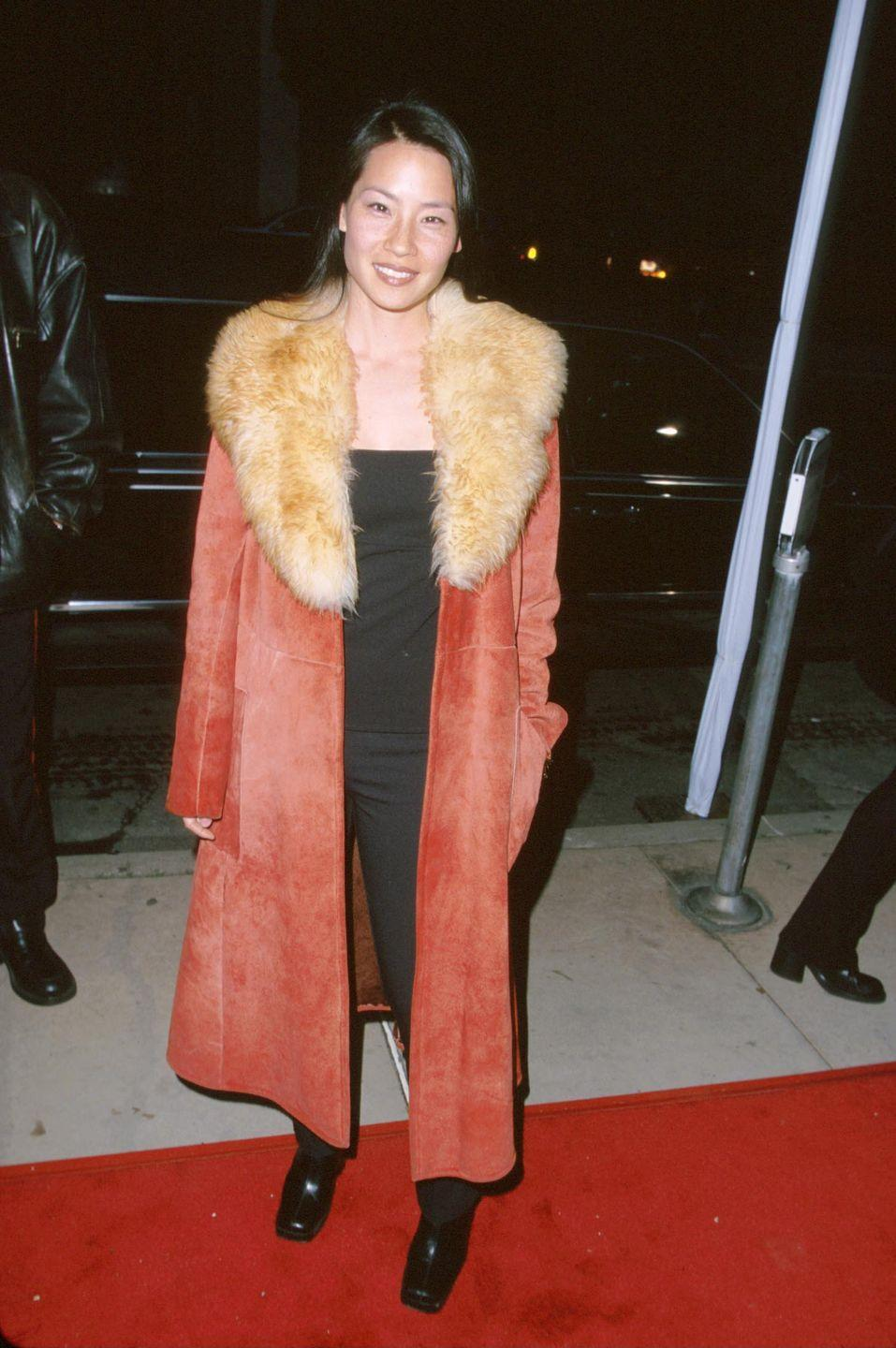<p>The <em>Charlie's Angels</em> actress bundled up on the red carpet in a red suede coat over a simple black tee and pants. </p>