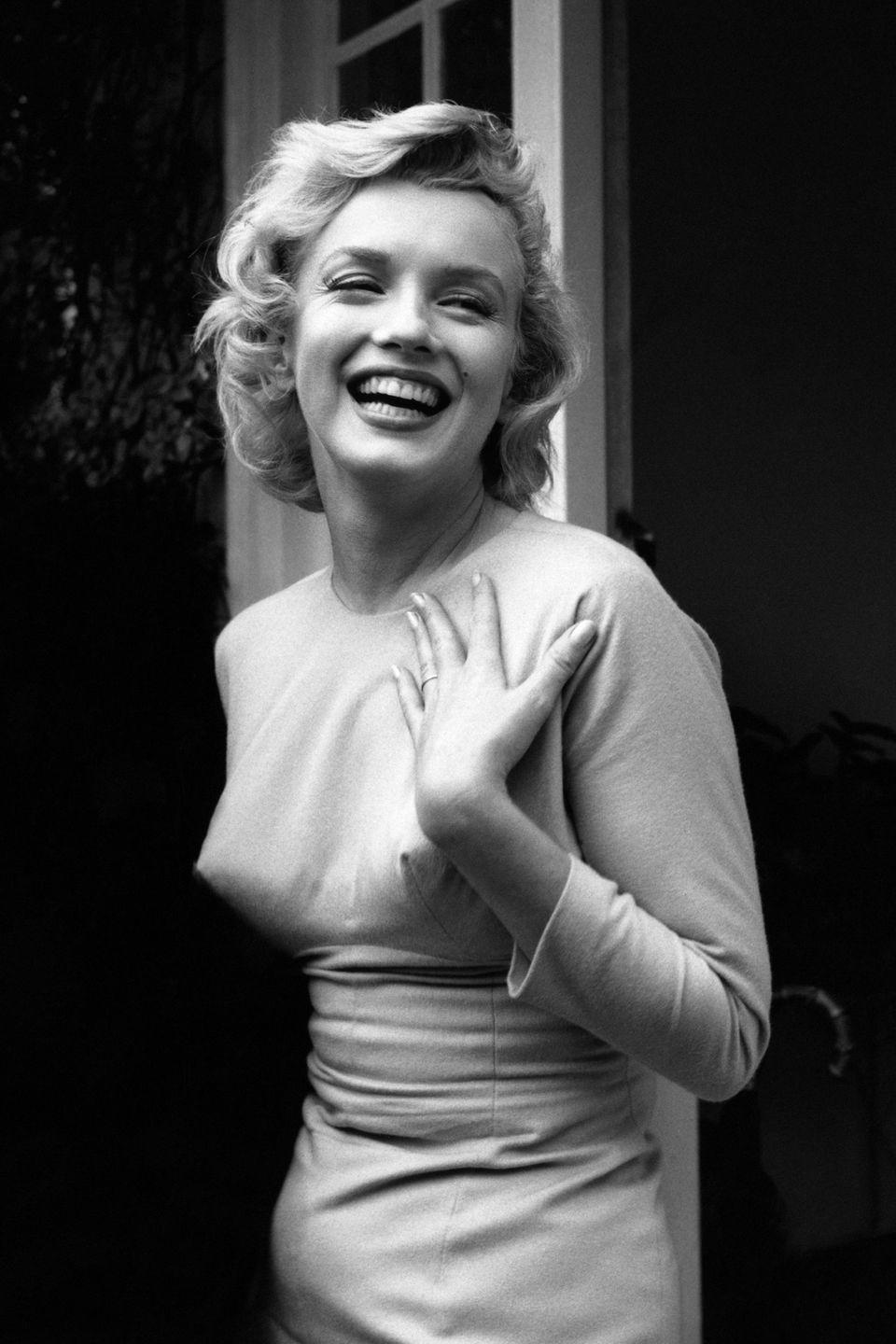 <p>Monroe smiling outside her home at Englefield Green.</p>