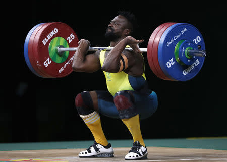 Weightlifting - Gold Coast 2018 Commonwealth Games - Men's 77kg Final - Carrara Sports Arena 1 - Gold Coast , Australia - April 7, 2018. Francois Etoundi of Australia competes. REUTERS/Paul Childs