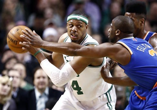 Boston Celtics' Paul Pierce, left, looks for an opening against New York Knicks' Raymond Felton during the first quarter of an NBA basketball game in Bostonn Tuesday, March 26, 2013. (AP Photo/Winslow Townson)