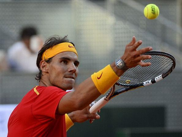 Rafael Nadal hits the ball into the crowd after defeating Ukraine's Sergiy Stakhovsky