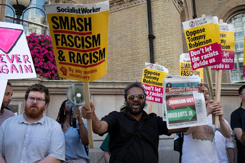 Demonstrators gather to oppose the Free Tommy Robinson demonstration, organised by anti-fascist groups including Stand up to Racism opposed to far right politics on 24th August 2019 in London, United Kingdom. Some 250 Stand Up To Racism and other anti-fascist groups took to the streets today in opposition to supporters of jailed Tommy Robinson real name Stephen Yaxley-Lennon at Oxford Circus, who gathered outside the BBC. (photo by Mike Kemp/In Pictures via Getty Images)