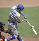 Los Angeles Dodgers' Chris Taylor connects for a base hit in the fourth inning of the first baseball game in a doubleheader against the San Francisco Giants, Thursday, Aug. 27, 2020, in San Francisco. (AP Photo/Ben Margot)