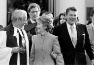 """FILE - In this January 1981 file photo, President-elect Ronald Reagan and his wife, first lady Nancy, leave St. John's Church in Washington, after attending services. The Greek Revival house of worship was consecrated in 1816 and often dubbed """"the Church of the Presidents"""" for having hosted every leader since James Madison for at least one service. (AP Photo)"""