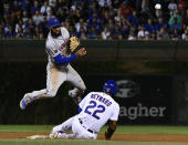 New York Mets shortstop Amed Rosario (1) turns a double play as Chicago Cubs' Jason Heyward (22) is forced out at second during the eighth inning of a baseball game on Tuesday, Aug. 28, 2018, in Chicago. (AP Photo/Matt Marton)
