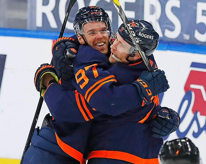 Edmonton Oilers forward Connor McDavid celebrates with Leon Draisaitl after Draisaitl's goal late in the second period. McDavid earned his 100th point of the season with an assist on the goal.