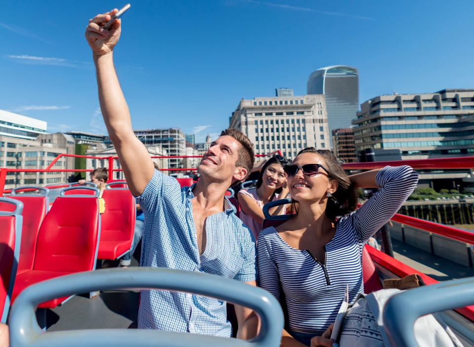 Hop on, hop off bus tours help you get the layout of the city. (Photo: andresr via Getty Images)