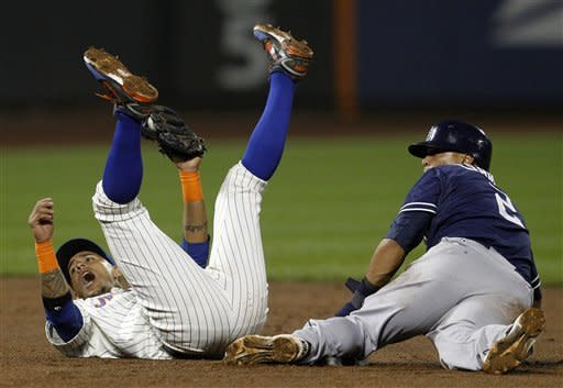 New York Mets shortstop Ronny Cedeno, left, protests the umpire's call on San Diego Padres' Everth Cabrera's stolen base in the fourth inning of their baseball game at Citi Field, Thursday, May 24, 2012, in New York. Cabrera, right, went on to score on Will Venable's RBI double. (AP Photo/Kathy Willens)