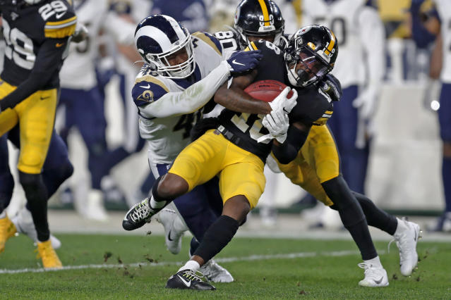 Pittsburgh Steelers wide receiver Diontae Johnson (18) is tackled by Los Angeles Rams linebacker Travin Howard (48) during the first half of an NFL football game in Pittsburgh, Sunday, Nov. 10, 2019. (AP Photo/Keith Srakocic)