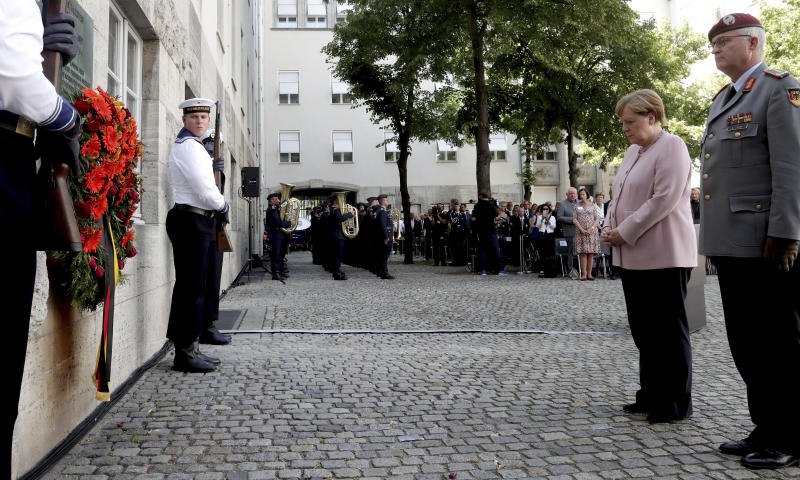 German Chancellor Angela Merkel, second right, attends a memorial event at the Defence Ministry in Berlin, Germany, Saturday, July 20, 2019. On July 20, 2019 Germany marks the 75th anniversary of the failed attempt to kill Hitler in 1944. (AP Photo/Michael Sohn)