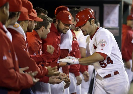 St. Louis Cardinals' Jaime Garcia is congratulated by teammates after hitting a solo home run during the third inning of a baseball game against the Cincinnati Reds, Monday, Oct. 1, 2012, in St. Louis. (AP Photo/Jeff Roberson)