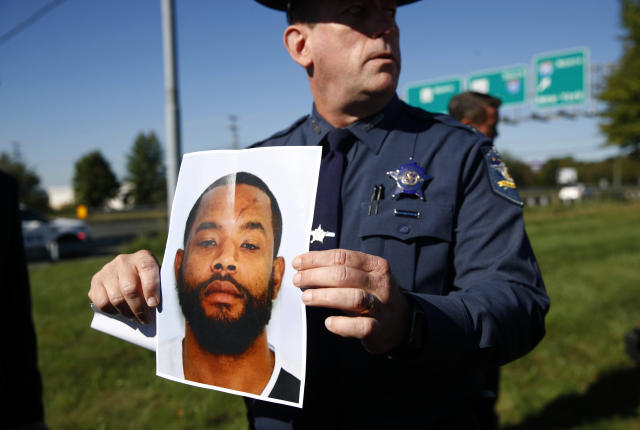 <p>Harford County Sheriff Jeffrey Gahler displays a photo of Radee Labeeb Prince, the suspect in a shooting at a business park in the Edgewood area of Harford County, Md., Wednesday, Oct. 18, 2017. (Photo: Patrick Semansky/AP) </p>
