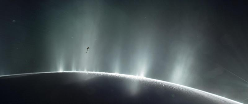 NASA's Cassini spacecraft is shown diving through the plume of Saturn's moon Enceladus, in 2015, in this photo illustration: Reuters