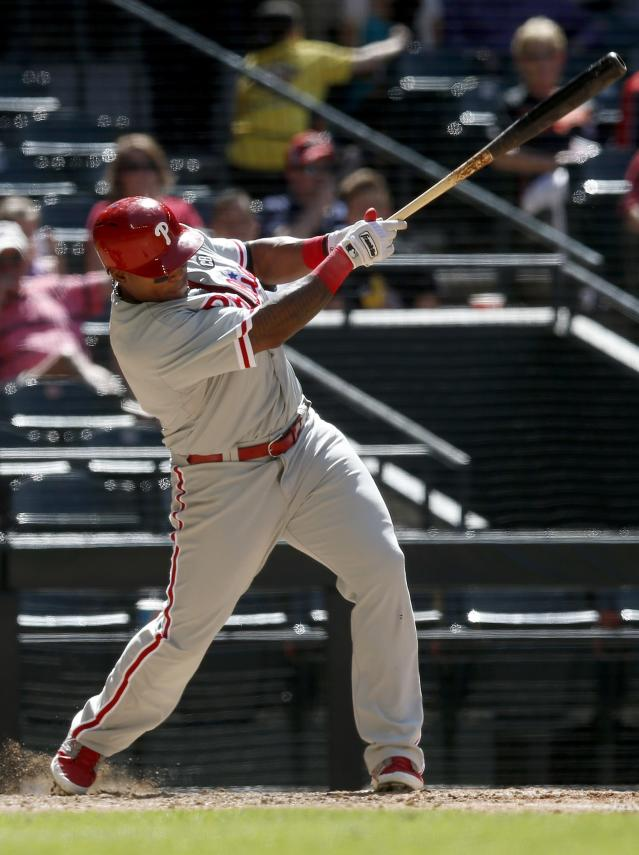 Philadelphia Phillies' Marlon Byrd connects for a single during the sixth inning of a baseball game against the Arizona Diamondbacks, Sunday, April 27, 2014, in Phoenix. (AP Photo/Ross D. Franklin)