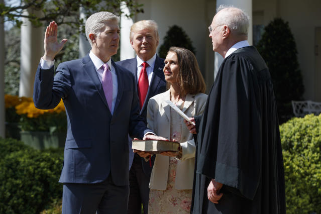 President Trump looks on as Supreme Court Justice Anthony Kennedy swears in Judge Neil Gorsuch, April 10, 2017. (Photo: Evan Vucci/AP)