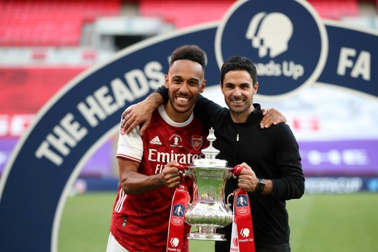 Mikel Arteta (right) is confident Pierre-Emerick Aubameyang (left) will remain at Arsenal