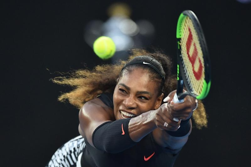 Serena Williams of the US hits a return against Venus Williams of the US during the women's singles final on day 13 of the Australian Open tennis tournament in Melbourne January 28, 2017