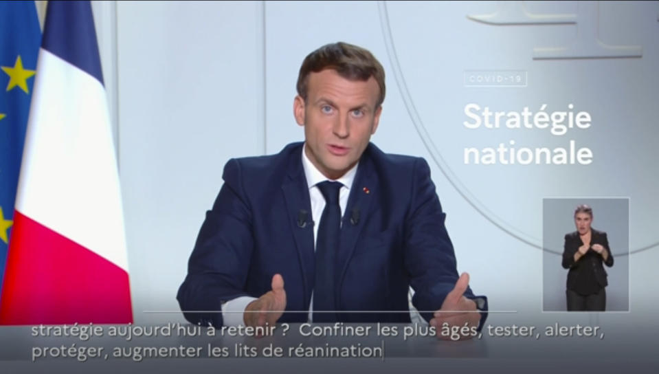 In this image made from video provided by TFI, France's President Emmanuel Macron makes a delivers a national address from Paris, Wednesday, Oct. 28, 2020. France announced a full nationwide lockdown for the second time this year and German officials imposed a partial four-week lockdown Wednesday, as governments across Europe sought to stop a fast-rising tide of coronavirus cases. (TFI via AP)