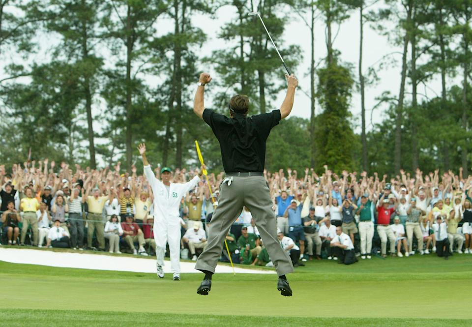 Phil Mickelson jumps in the air after making birdie on the 18th hole to win The Masters by one shot during the final round of The Masters at the Augusta National Golf Club on April 11, 2004, in Augusta, Georgia.