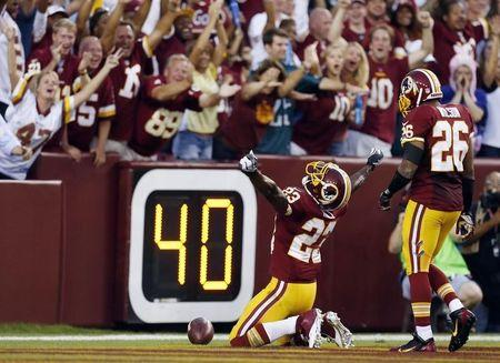 Redskins' Hall celebrates a touchdown while on his knees during the first-half of their NFL football game against the Eagles in Landover