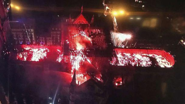 PHOTO: An image taken from a television screen shows an aerial view of the Notre-Dame Cathedral engulfed in flames on April 15, 2019, in the French capital Paris. (AFP/Getty Images)