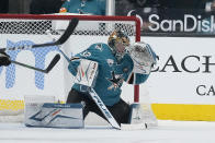 San Jose Sharks goaltender Josef Korenar (32) blocks a shot against the Colorado Avalanche during the first period of a hockey game in San Jose, Calif., on Wednesday, May 5, 2021. (AP Photo/Tony Avelar)