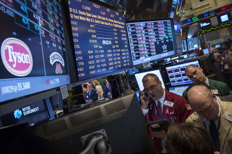 File of traders gathering at the post that trades Tyson Foods on the floor of the New York Stock Exchange